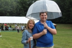 man and woman hanging out under umbrella