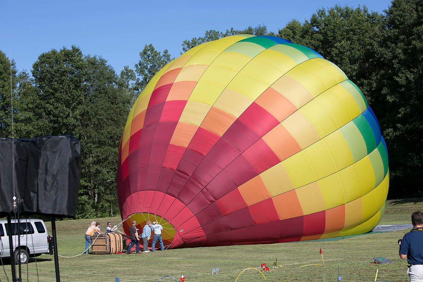 hot air balloon filling up on field