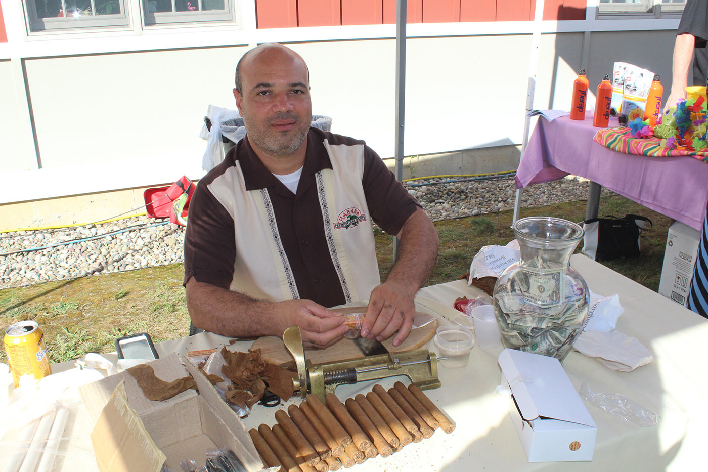 man hand rolling cigars