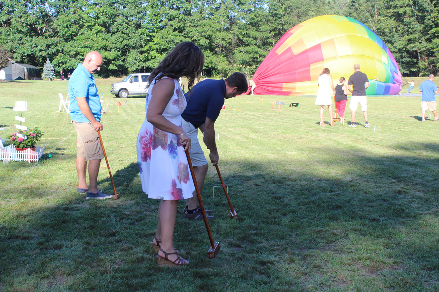 groups of people playing croquet