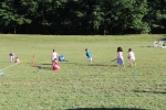 bunch of children playing in field