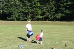 man and child playing in kid field