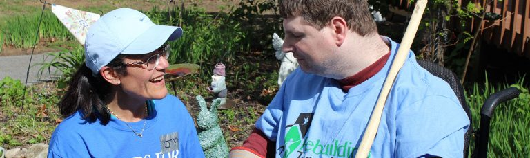 AIM Services Team Member Encouraging a Developmentally Disabled Person