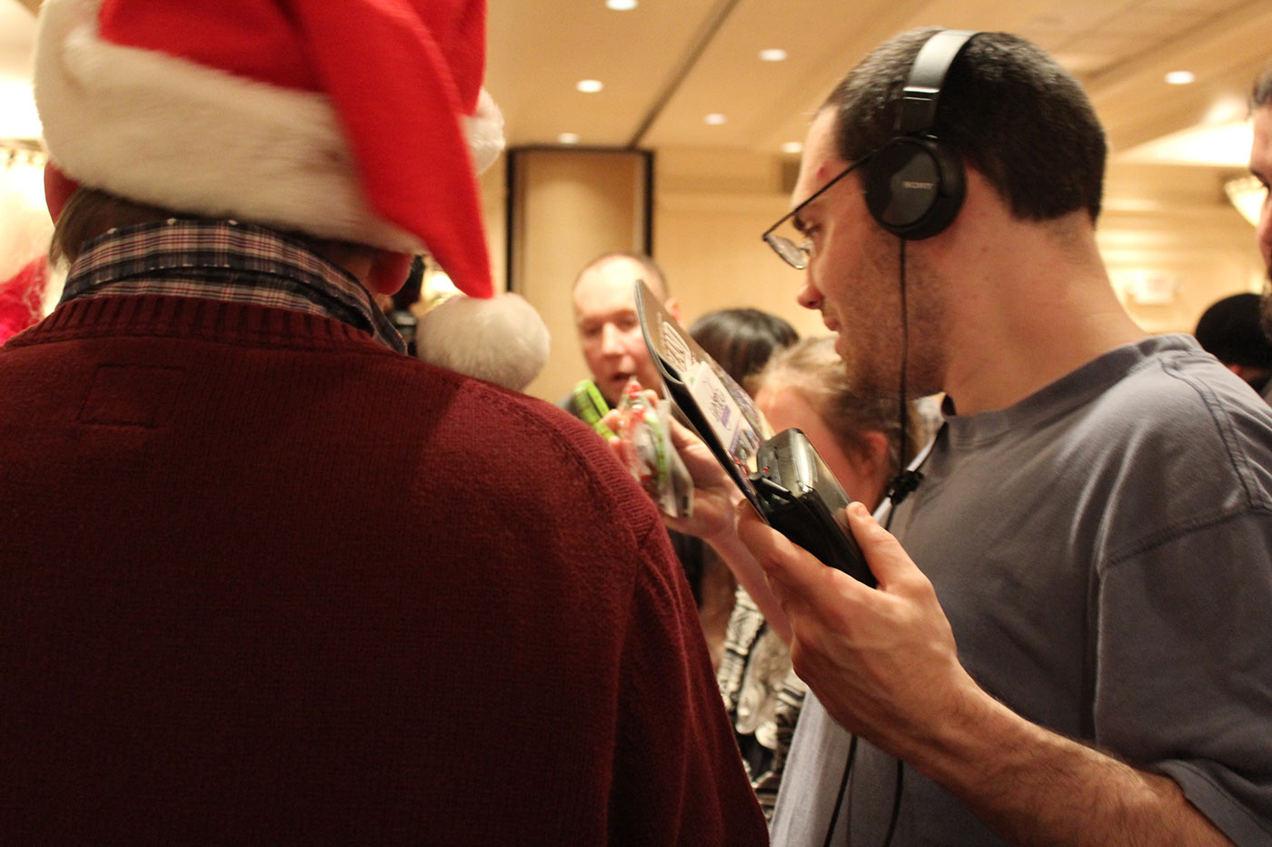 man wearing headphones checks out his gifts