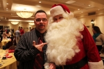 man taking a picture pointing with santa