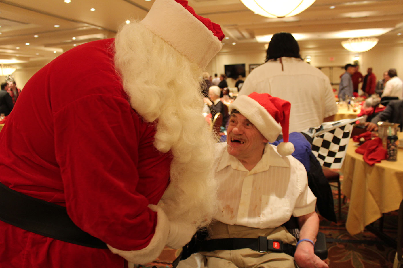 santa saying hello to man in wheelchair