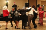 Cute people dancing together on dance floor