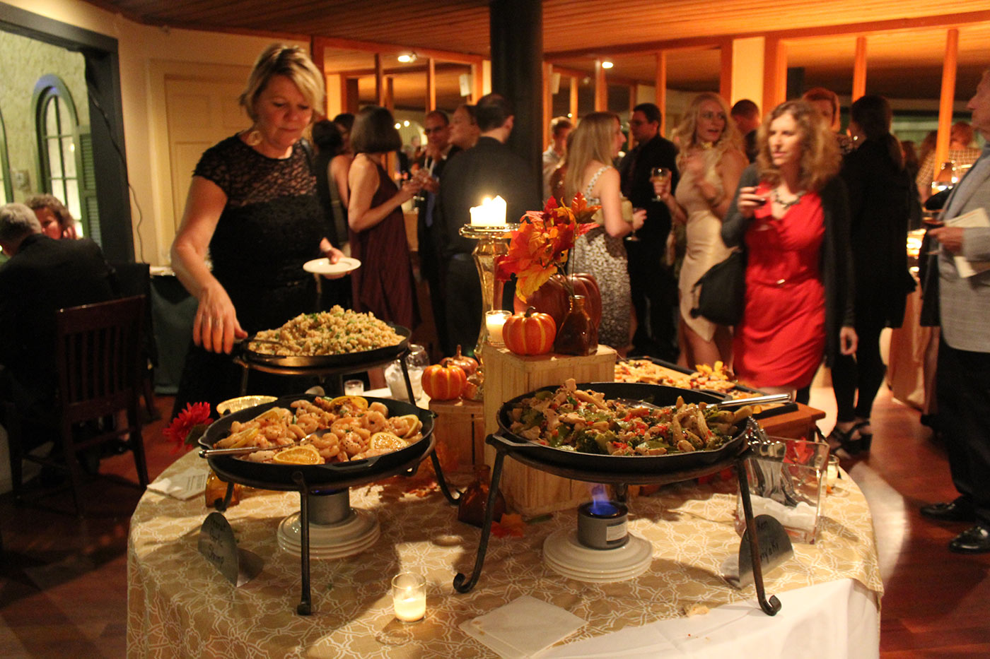 woman getting food at catering table