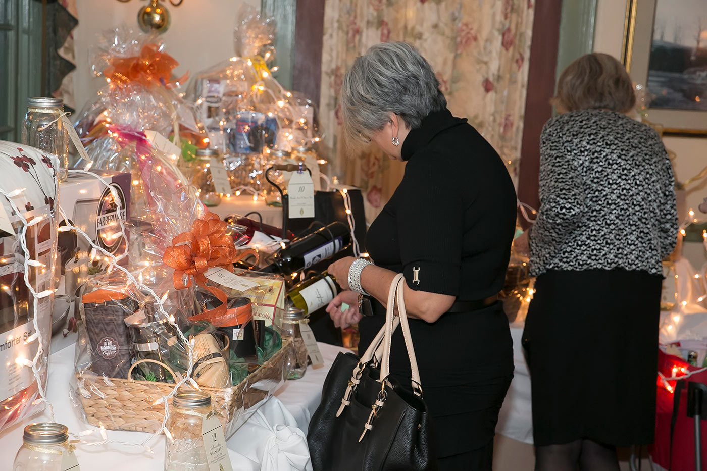 woman perusing the raffle table