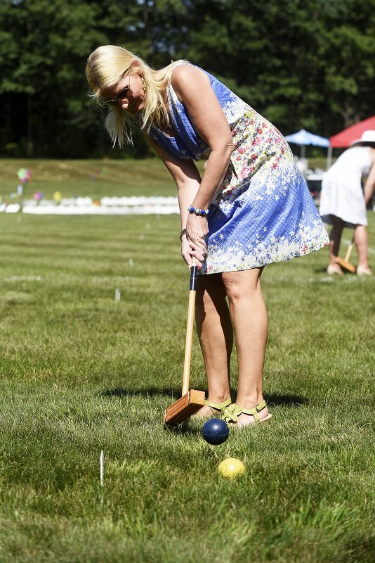 Croquet player taking a shot at Croquet on the Green