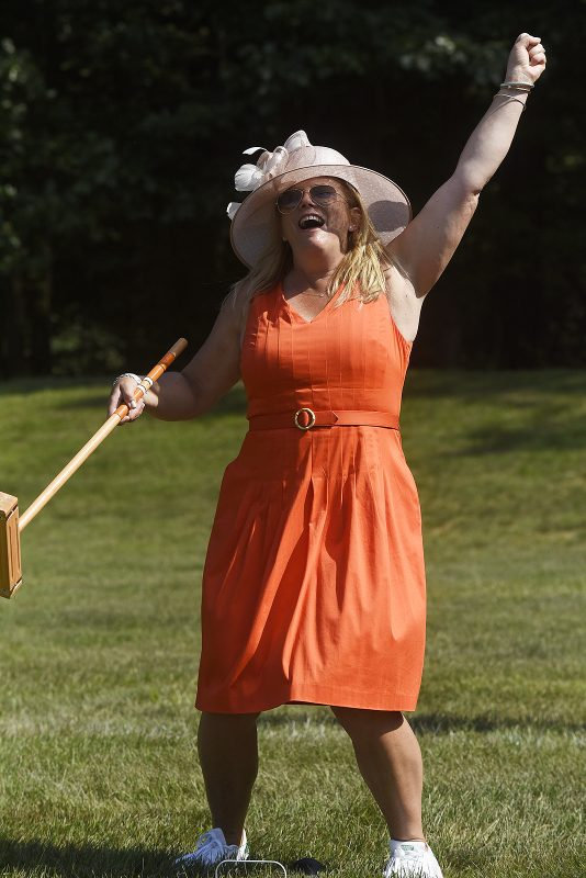 Croquet player celebrating win at Croquet on the Green