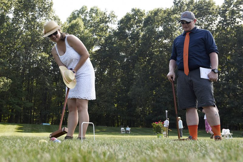 Couple playing at Croquet on the Green