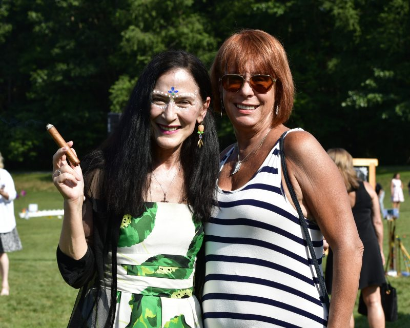 Women with cigar and women in stripe dressed