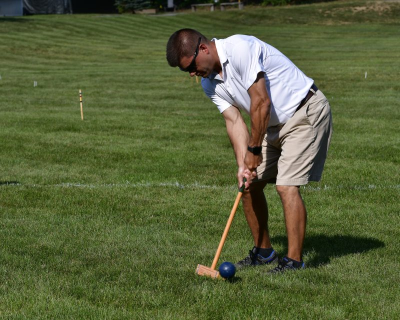 Man hiiting ball on the Croquet on the Green