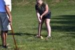 Women hitting yellow ball