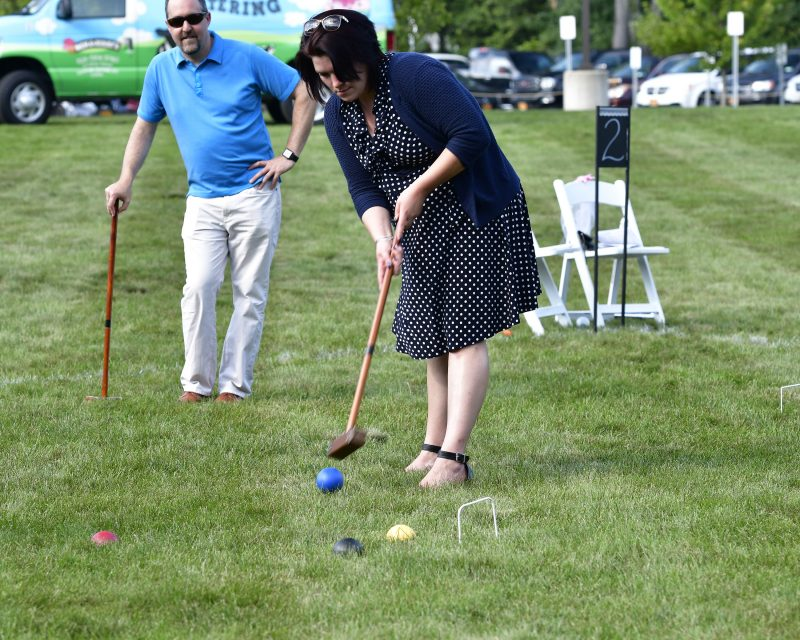 Woman in dark blue dresses Croquet on the Green