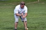 Man with cigar hitting through a wicket