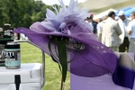 Purple hat and matching scarf raffle item donated by Saratoga Trunk
