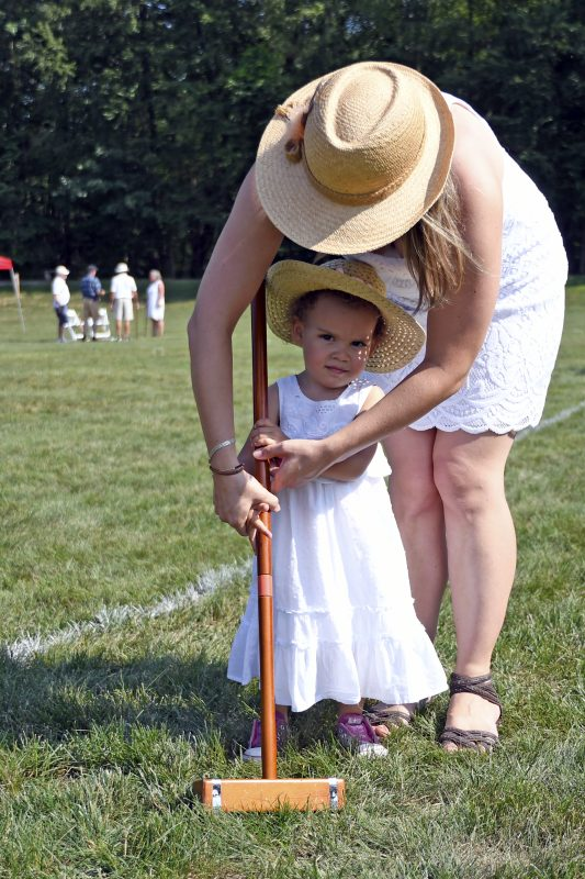 Croquet on the green mom and daughter
