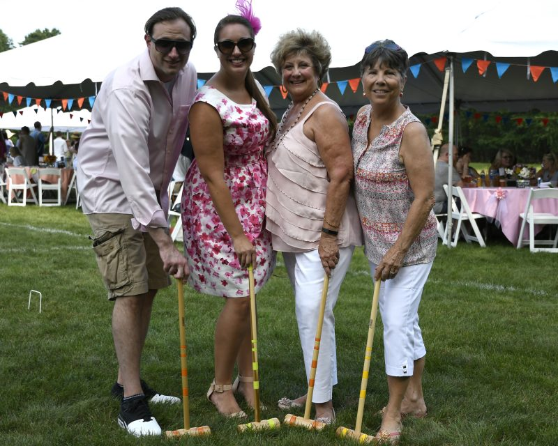 4 People hold Croquet clubs