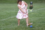 Croquet on the Green women swinging at blue ball