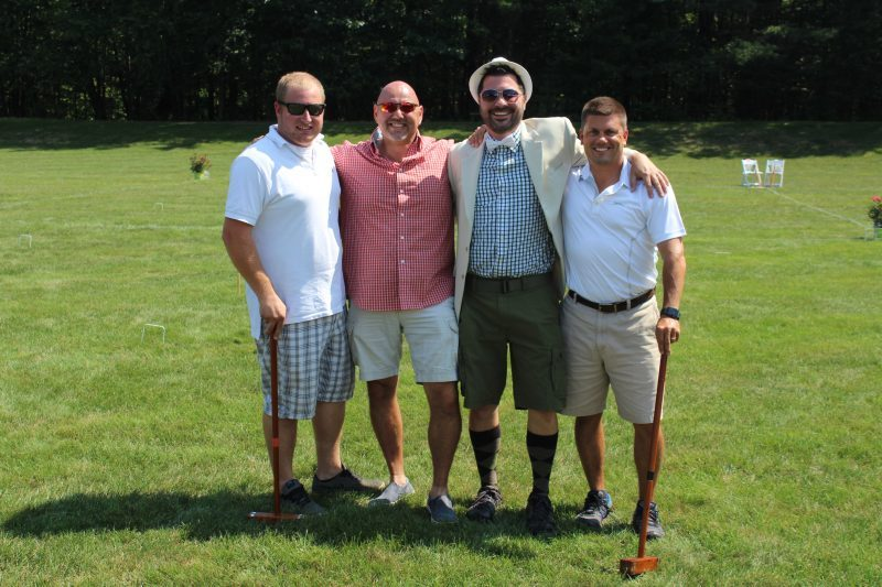 Four croquet players on the feild at Croquet on the Green