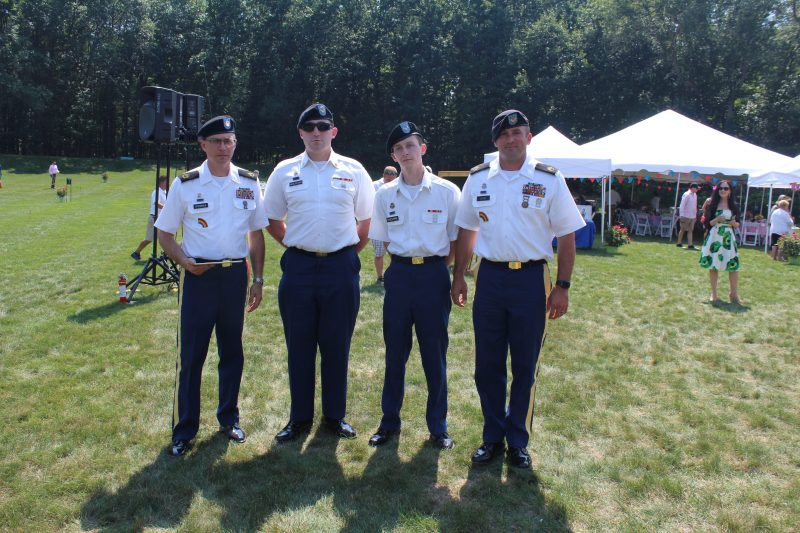 Four men from the 42nd Infantry Division Band