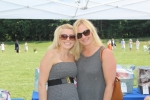 2 Women at the Croquet on the Green in grey dresses