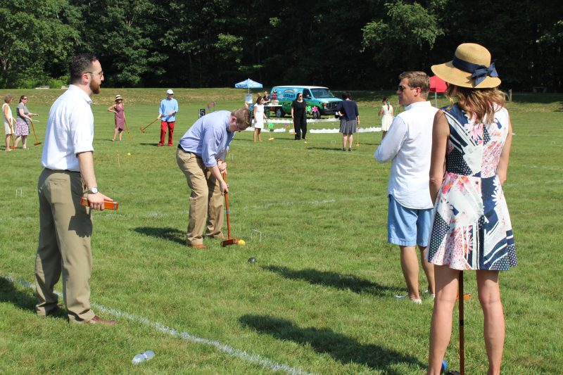 Group of men and women playing croquet at Croquet on the Green