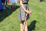 Croquet player at Croquet on the Green in dark dress
