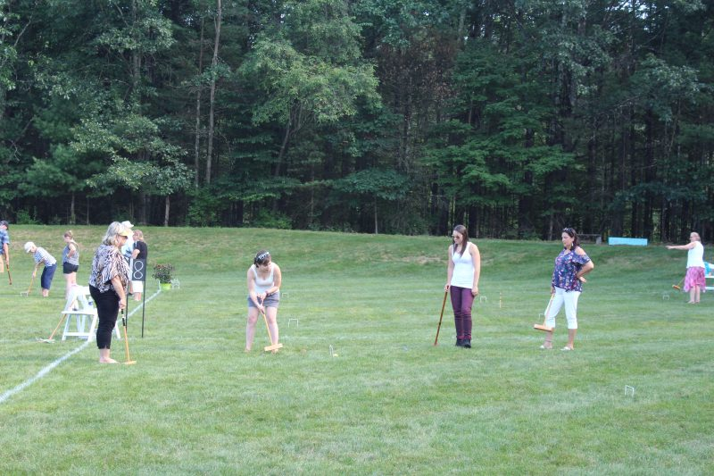 Women playing Croquet on the Green
