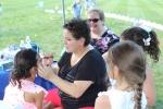 Women kids face painting