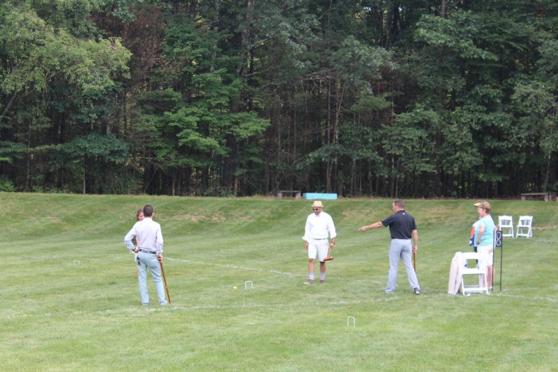 Croquet on the Green players viewing their shots
