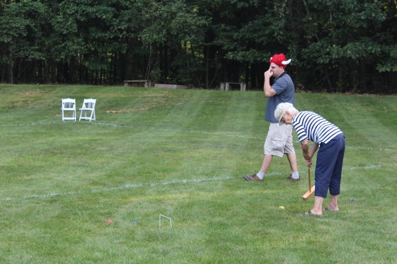 Croquet on the Green players. Man in viking hat