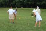 Croquet on the Green players hitting Croquet balls