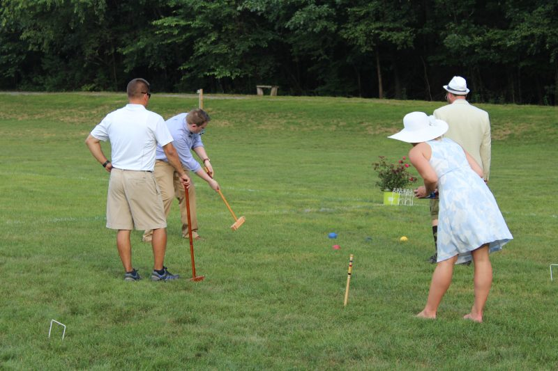 Croquet on the Green players hitting Croquet balls