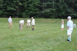 Group of Croquet on the Green players on grass