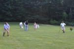 Croquet on the Green players hitting long shot