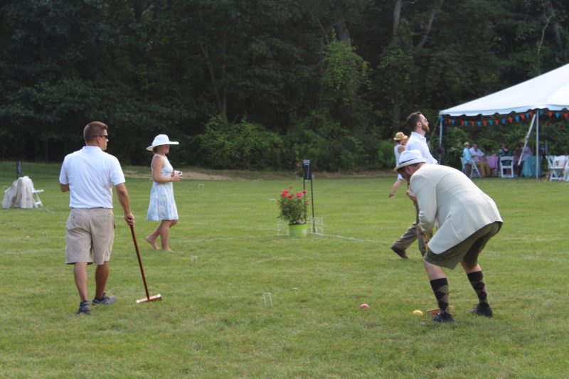 Croquet on the Green man lining up shot