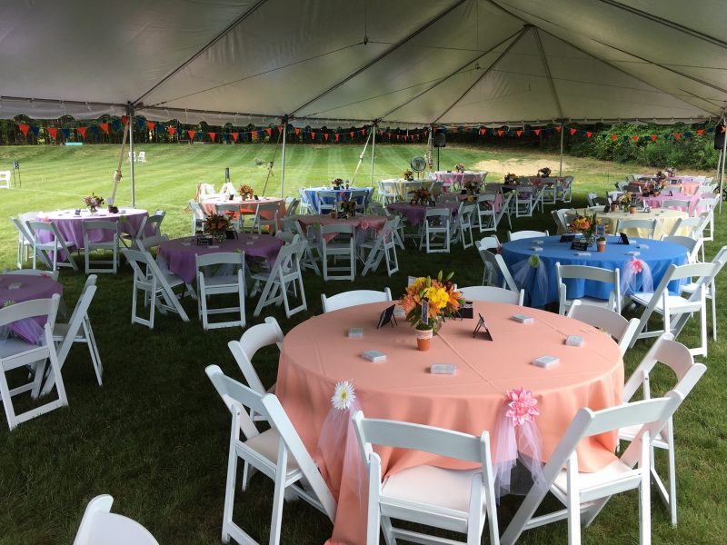 Set up of tables at Croquet on the Green Garden Party