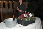 Bill Blake presenting a bottle of wine at the Vin Le Soir event
