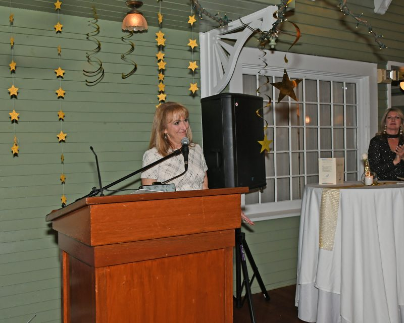 Benita Zahn speaking at the Vin Le Soir event
