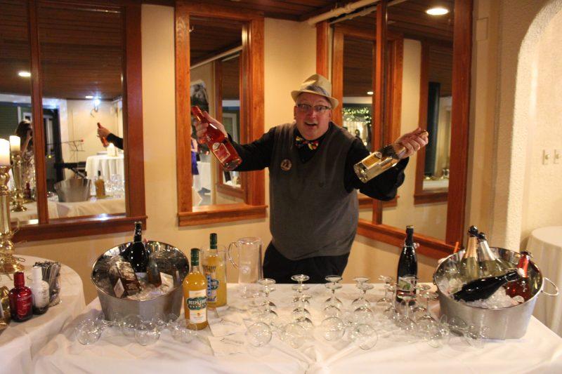 Keith Barnett presenting two bottles of Santero