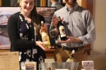 Staff from Adirondack Winery presenting two bottles of wine