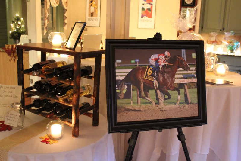 High End Raffle photograph of a famous horse Songbird in Flight at Saratoga Race Track at Vin Le Soir event