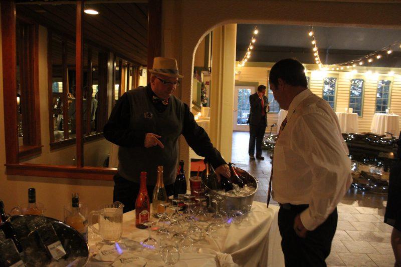 Keith Barnett describing wine to a man at Vin Le Soir