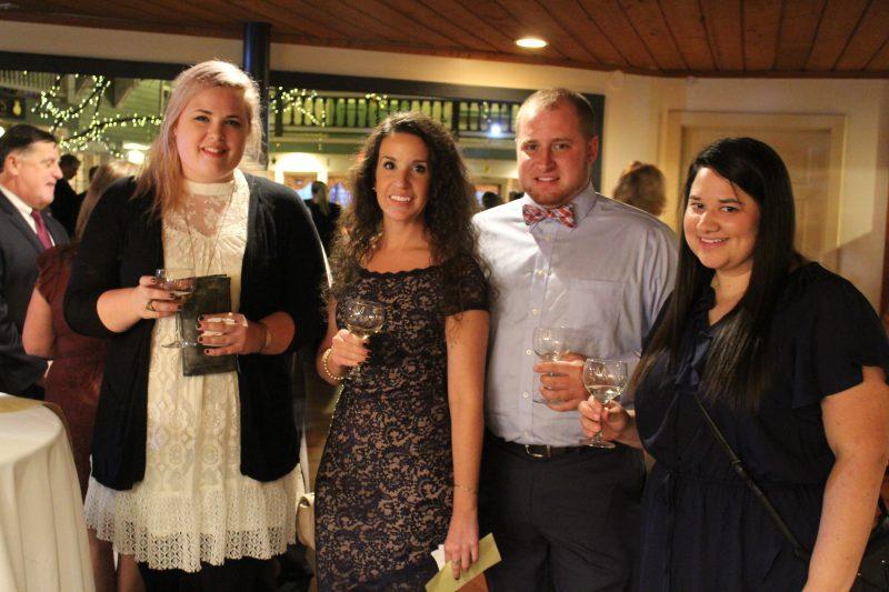 Amber Suttle, Kristi Williams, Damon Casey, Ashley Stark enjoying the Vin Le Soir event