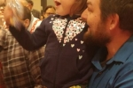 Little girl smiling with dad at Holiday Tea party