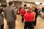 Group of people dancing at the Holiday Tea event