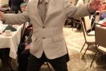 Man dancing at the Holiday Tea